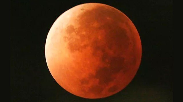 In this Aug. 28, 2007, file photo, the moon takes on different orange tones during a lunar eclipse seen from Mexico City. (AP Photo/Marco Ugarte)