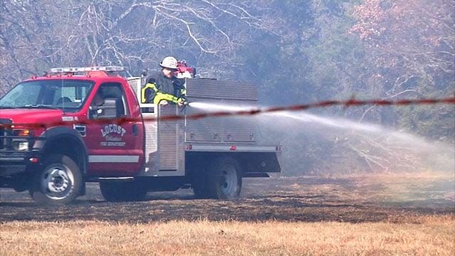 The Locust Volunteer Fire Department helps control a grass fire near Denison on Wednesday. (KTEN)