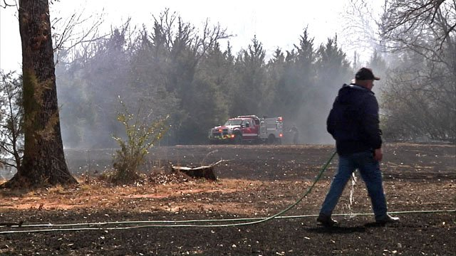 A welder's torch touched off this grass fire on South Fannin Avenue in Denison. (KTEN)