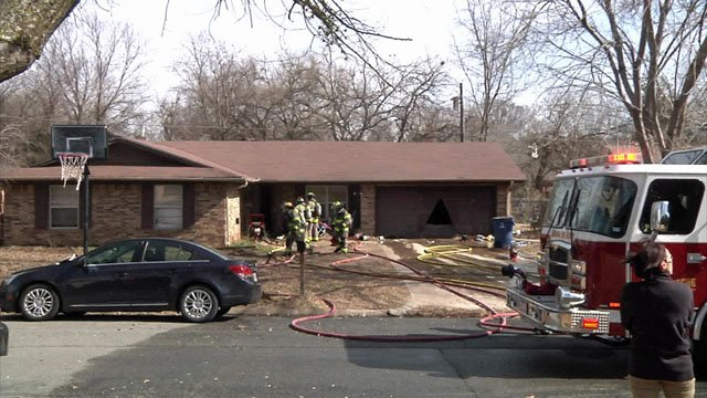 A faulty light fixture is blamed for the fire at this home on Dean Drive in Denison. (KTEN)