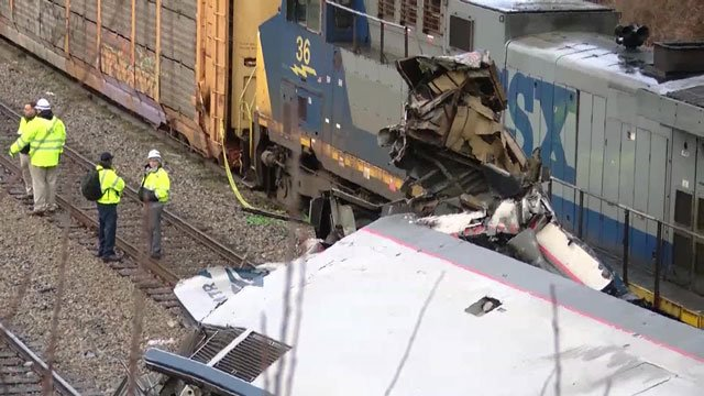 Emergency crews survey the wreckage of a train crash in South Carolina that left two Amtrak employees dead. (WIS)