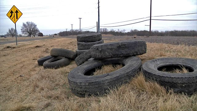 Tires dumped by the side of a Grayson County highway. (KTEN)