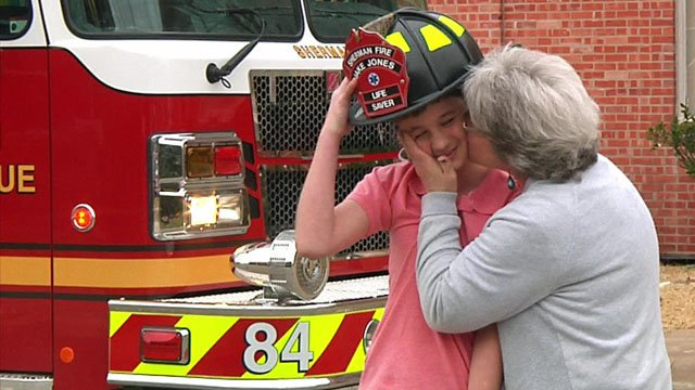 Jake Jones, 13, gets a kiss from his grateful grandmother, Deborah Boyer. (KTEN)