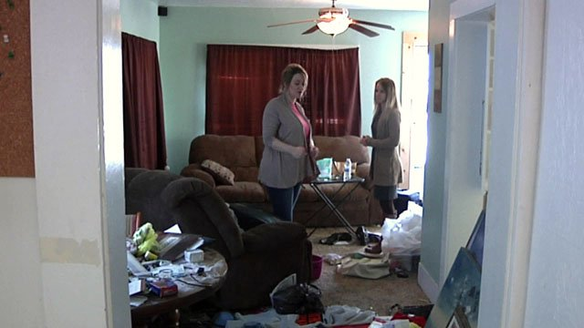 Adriane Johnston shows her ransacked home to a KTEN reporter. (KTEN)