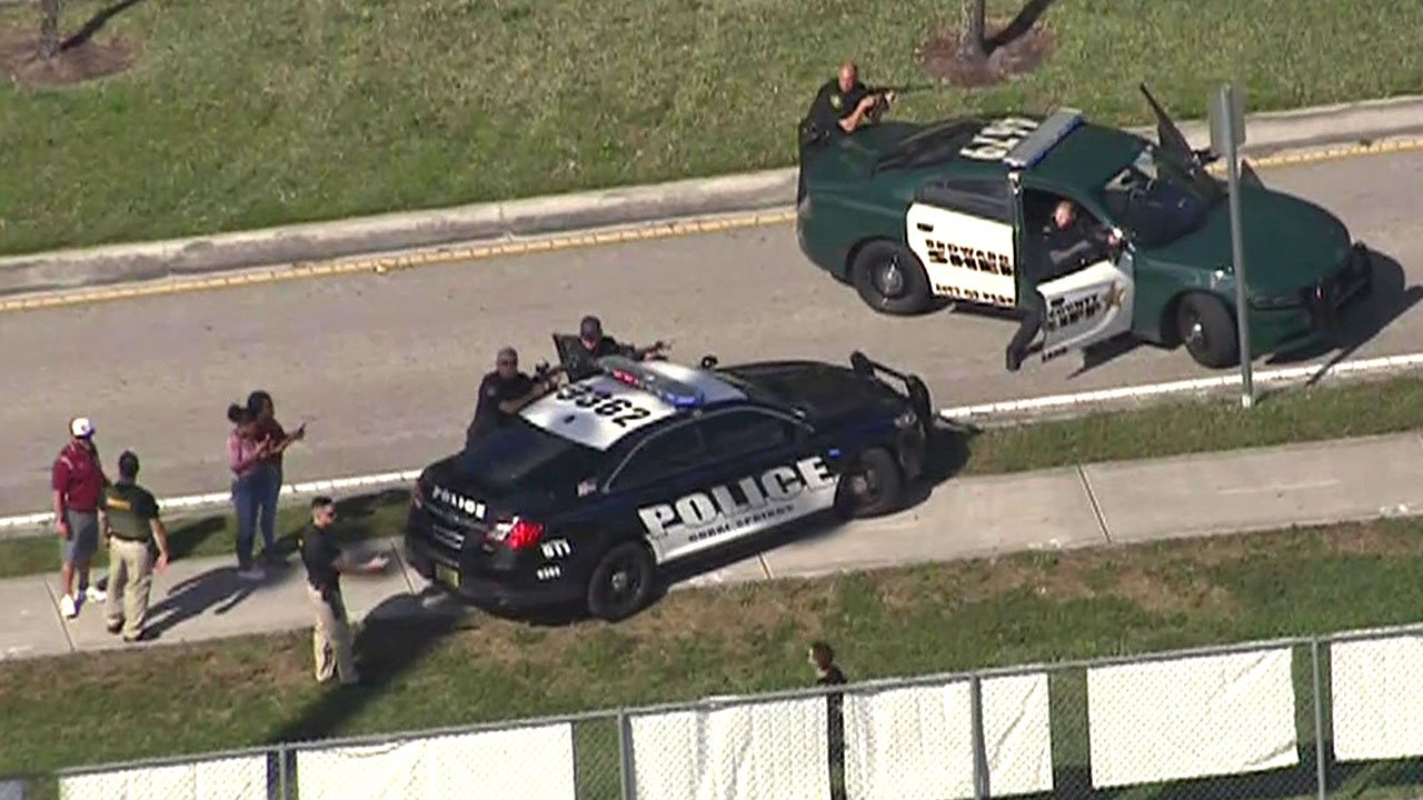 Police surround Marjory Stoneman Douglas High School in Parkland, Florida. (WSVN via CNN)
