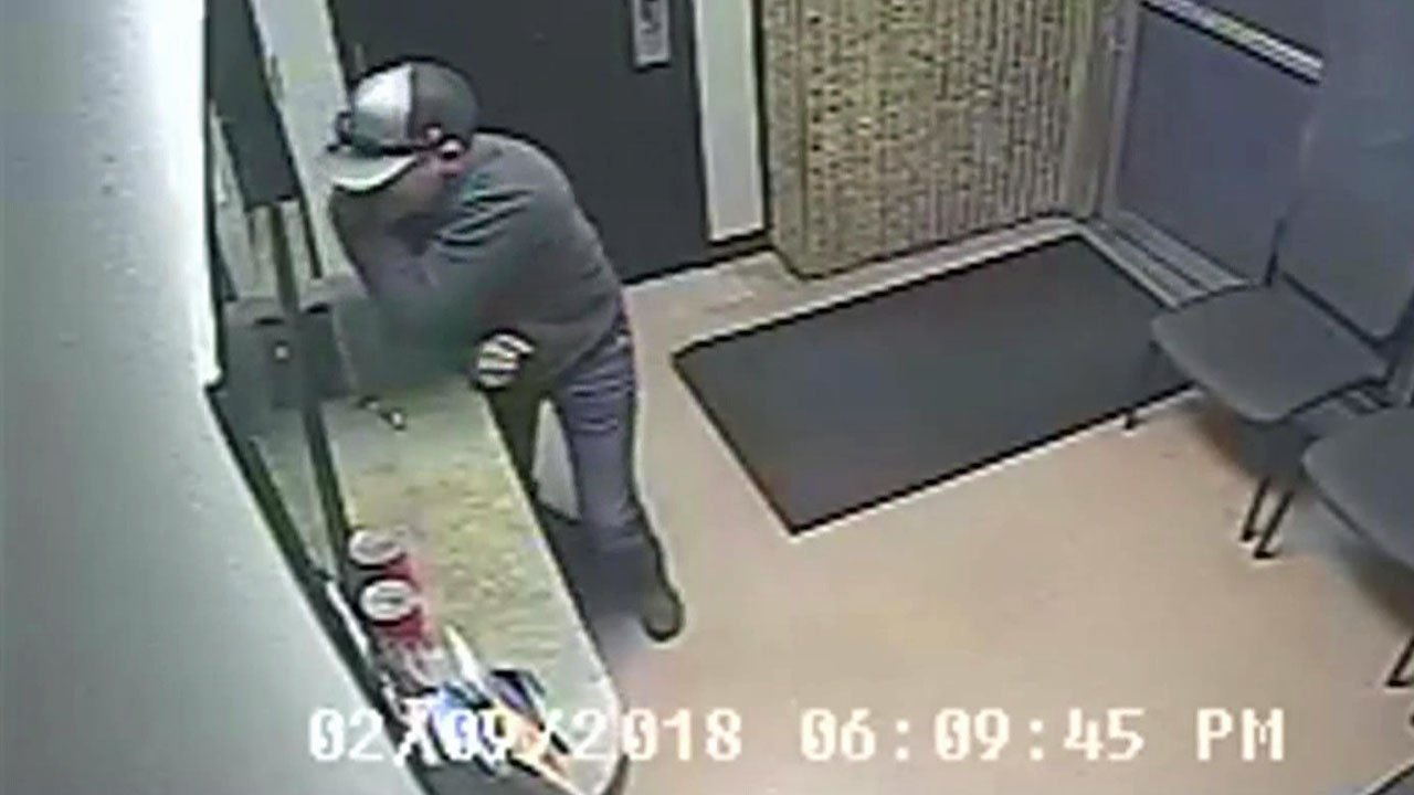 Surveillance video shows Colby Rushing staggering into the Lindsay police station after being stabbed in the back. (Lindsay PD)