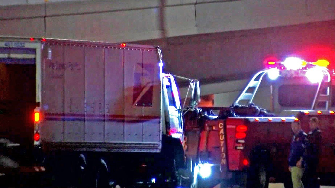 The driver of this U.S. Postal Service vehicle was found shot Monday along a Dallas highway. (KTEN)