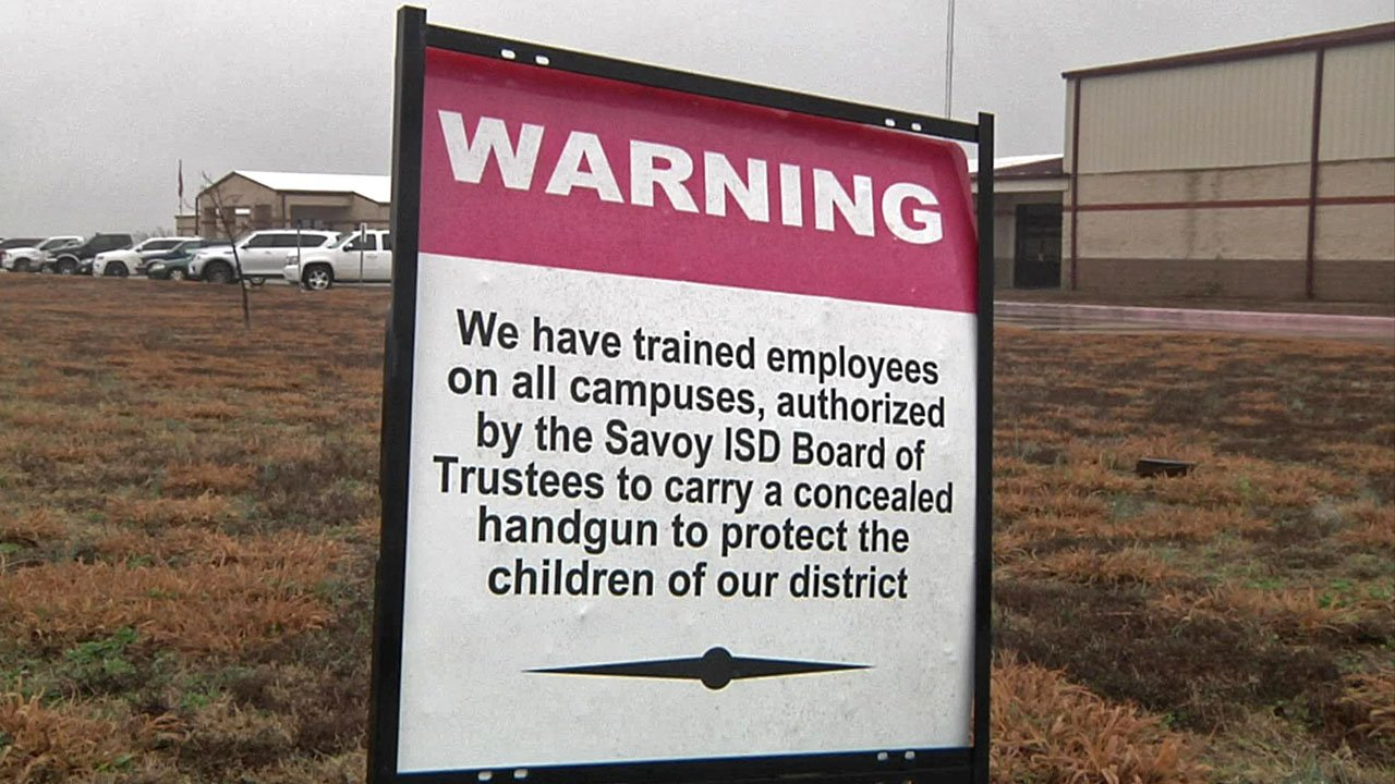 Savoy High School has signs warning that some staffers are armed. (KTEN)