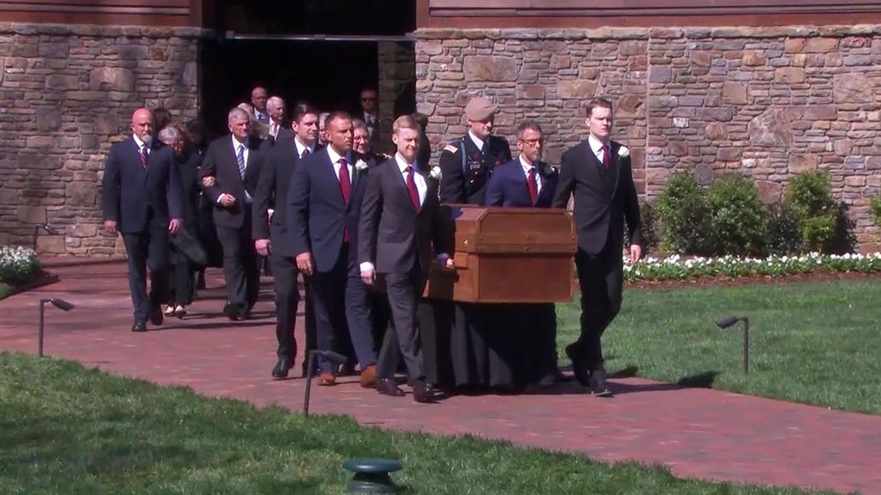 Pallbearers bring Billy Graham's casket to his funeral service. (NBC News)
