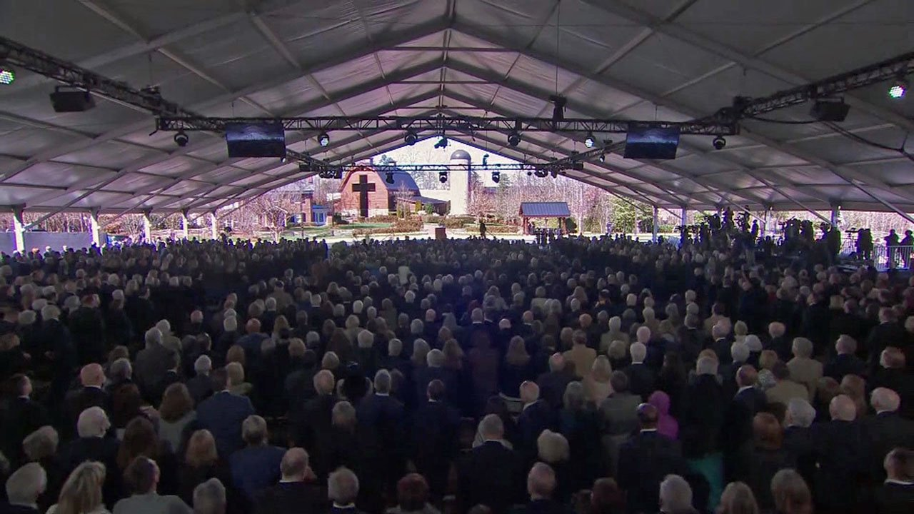Billy Graham's funeral service was conducted under a large tent. (NBC News)