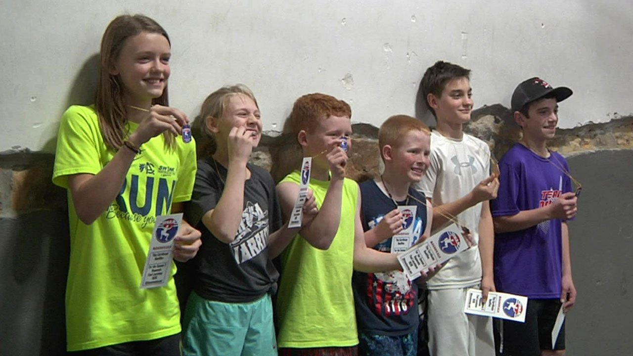Youngsters display their awards after a Ninja fitness event in Ardmore. (KTEN)