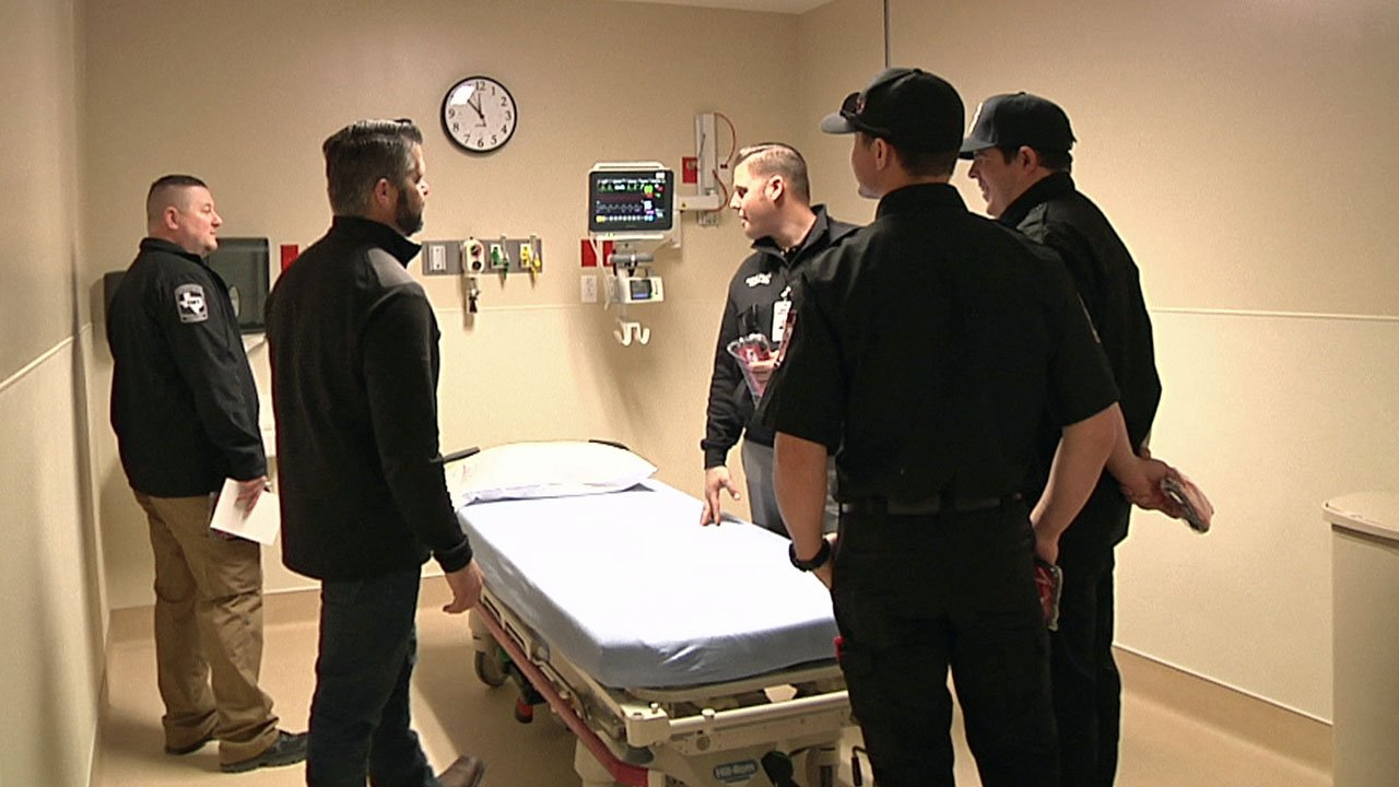 Emergency responders inspect one of the new emergency rooms at Texoma Medical Center. (KTEN)