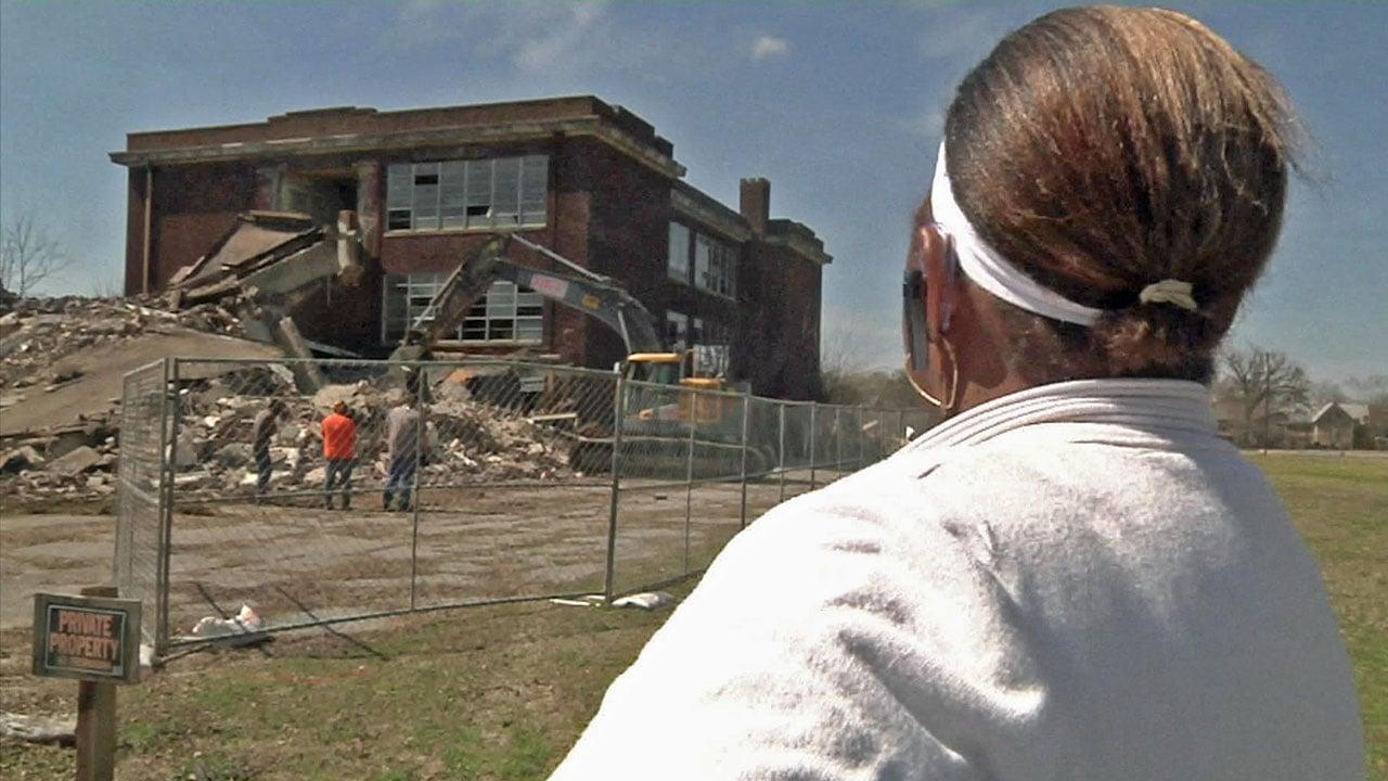 Gloria Caywood looks on as her childhood school is demolished in Denison. (KTEN)