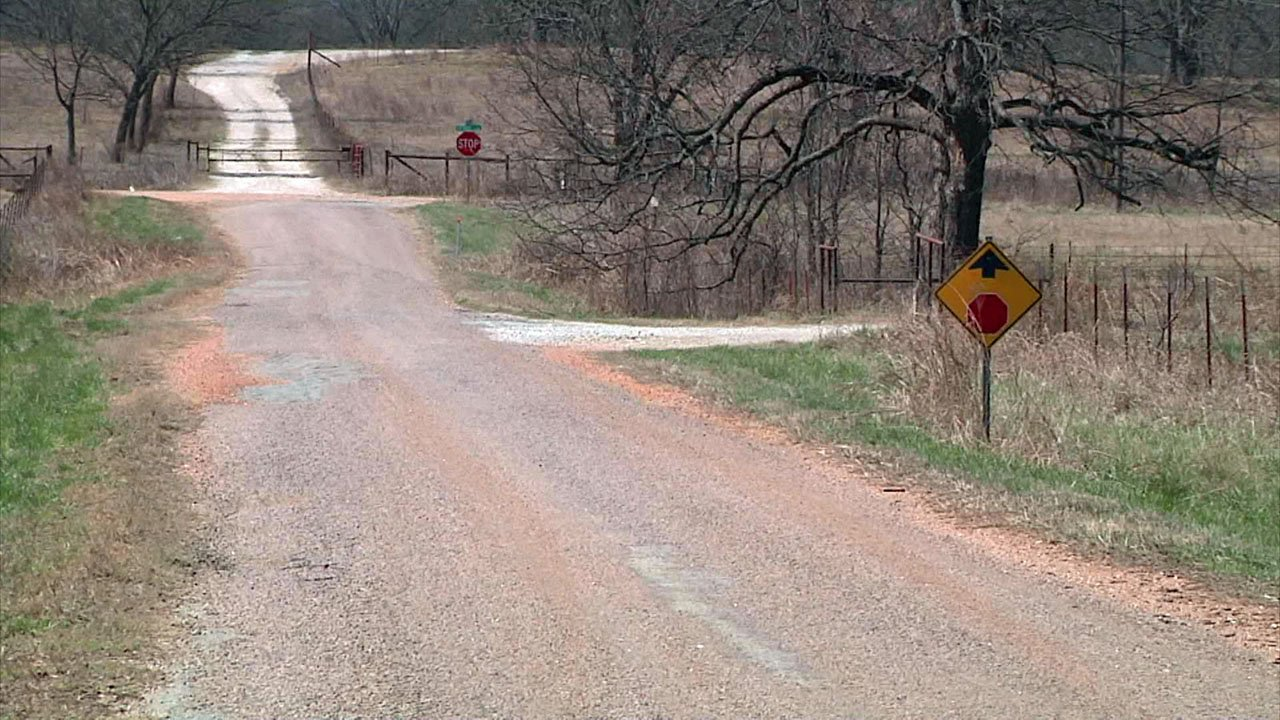 Two 11-year-old girls said they were fired on from an older black pickup truck on this rural road in Pushmataha County. (KTEN)