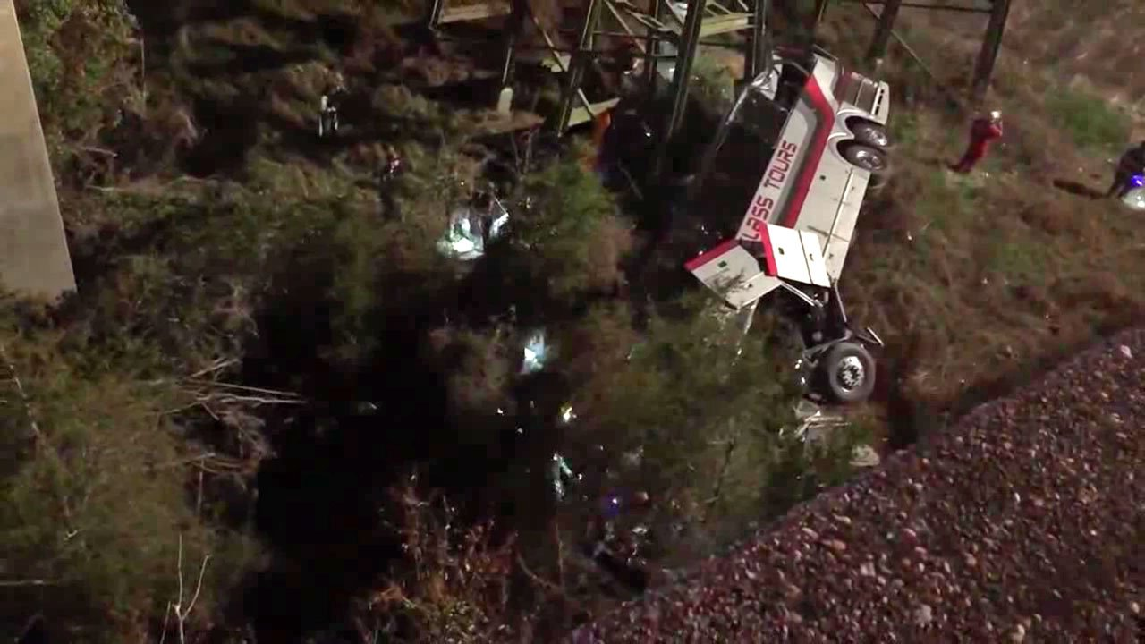 A tour bus lies on its side in a ravine along an Alabama highway. (Courtesy Jesus Tejeda)