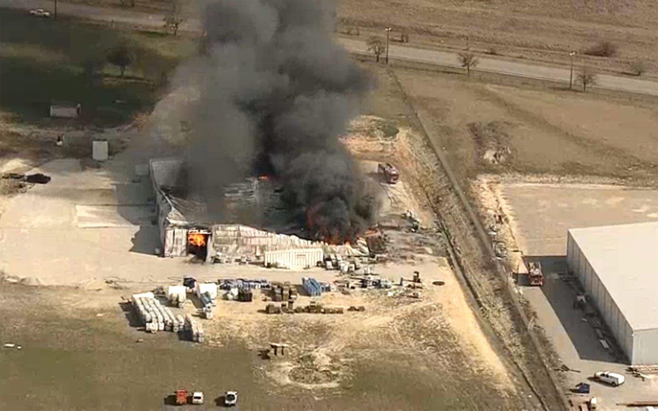 Fire burns at the Tri-Chem Industries plant in Cresson, Texas. (KXAS via NBC News)