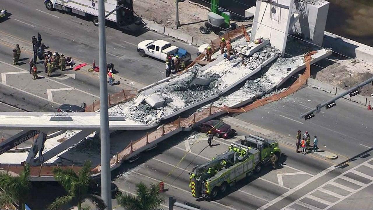 Multiple vehicles were crushed when a pedestrian bridge collapsed near Miami. (WSVN via CNN)