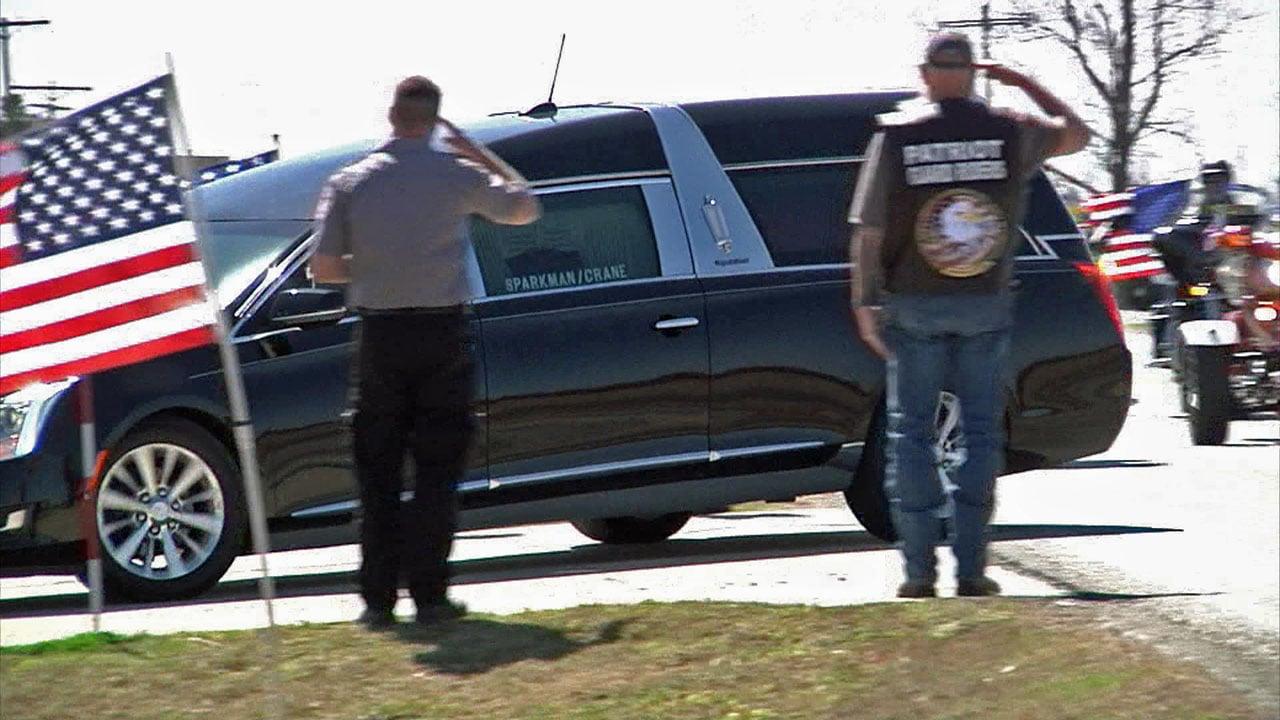 A hearse bearing the casket of Dallas firefighter Brian McDaniel arrives in Coleman, Oklahoma. (KTEN)