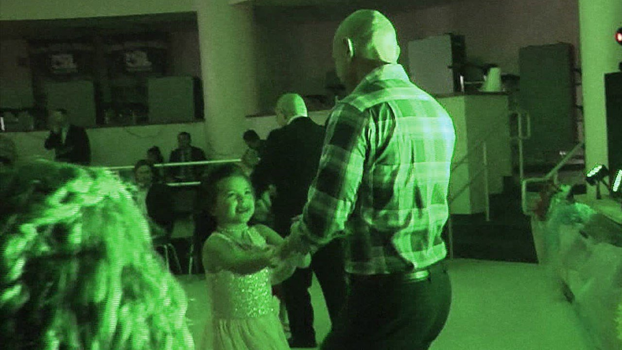 Sherman police Sgt. Paxton Emerson dances with Sophie Castellanos at the Ties & Tiaras event in Howe. (KTEN)