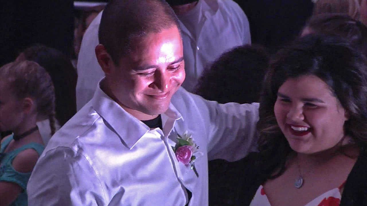 Sherman police Officer Bradley Richards dances with Julie Castellanos. (KTEN)