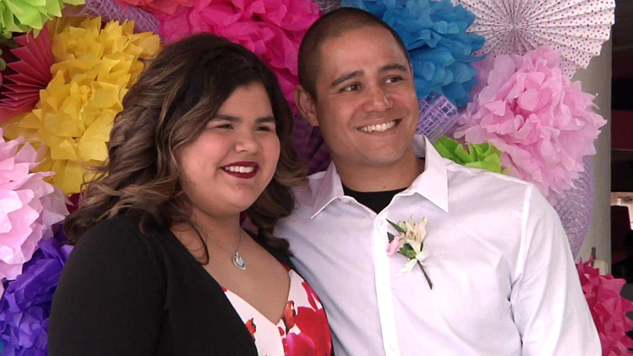 Julie Castellanos poses for a photo with Sherman police Officer Bradley Richards. (KTEN)
