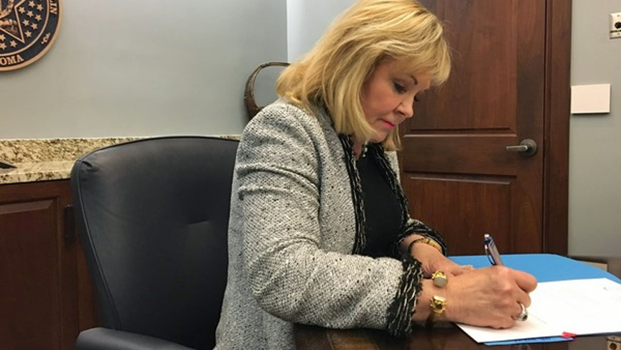 Gov. Mary Fallin signs legislation adding funding for public school education. (Photo: Governor's office)