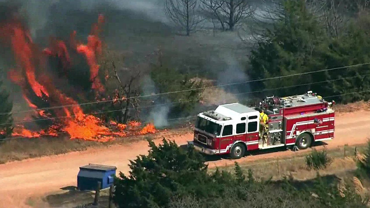 Firefighters from multiple agencies are scrambling to contain large wildfires in western Oklahoma.