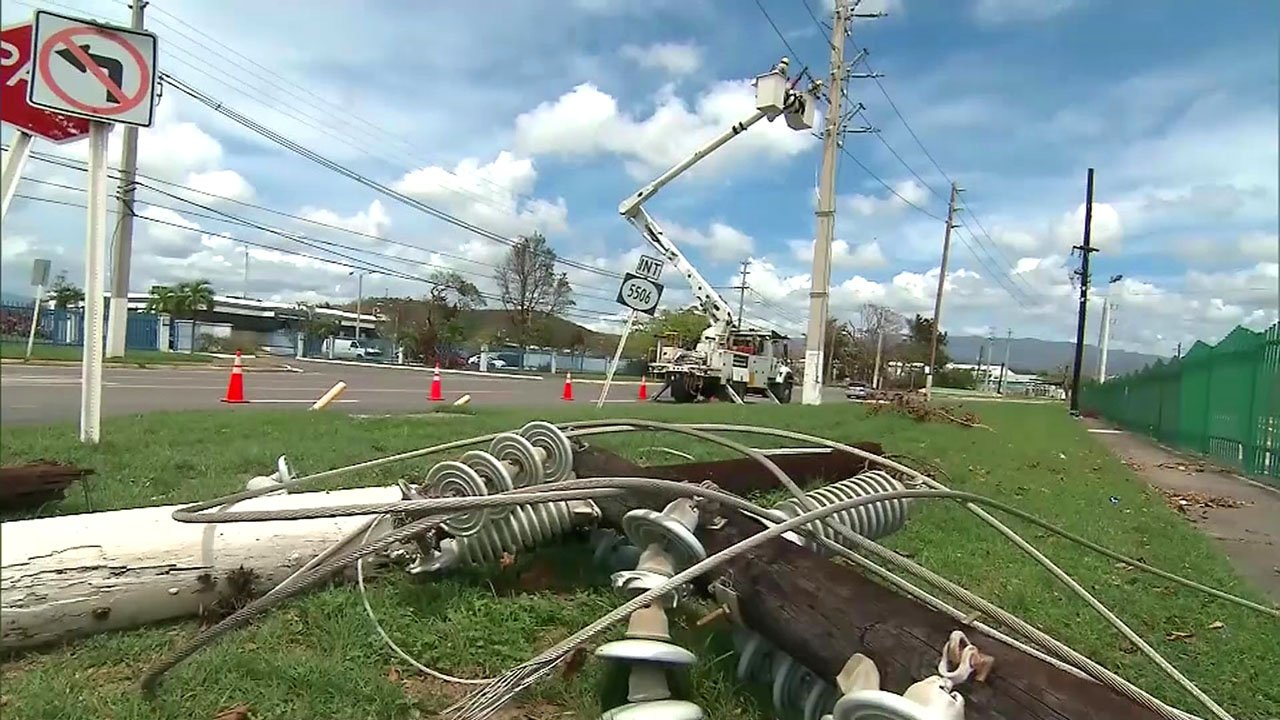 Linesmen work to restore power in Puerto Rico. (CNN)