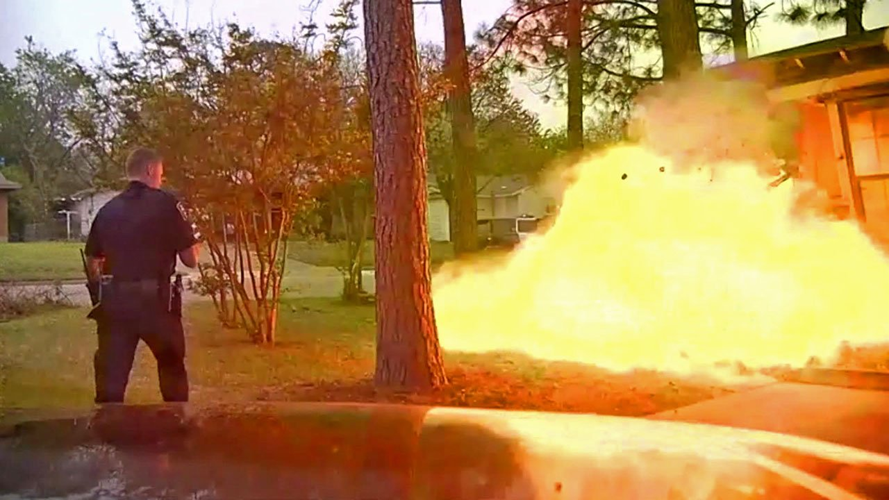 Police officer narrowly avoids explosion after SUV slams into home