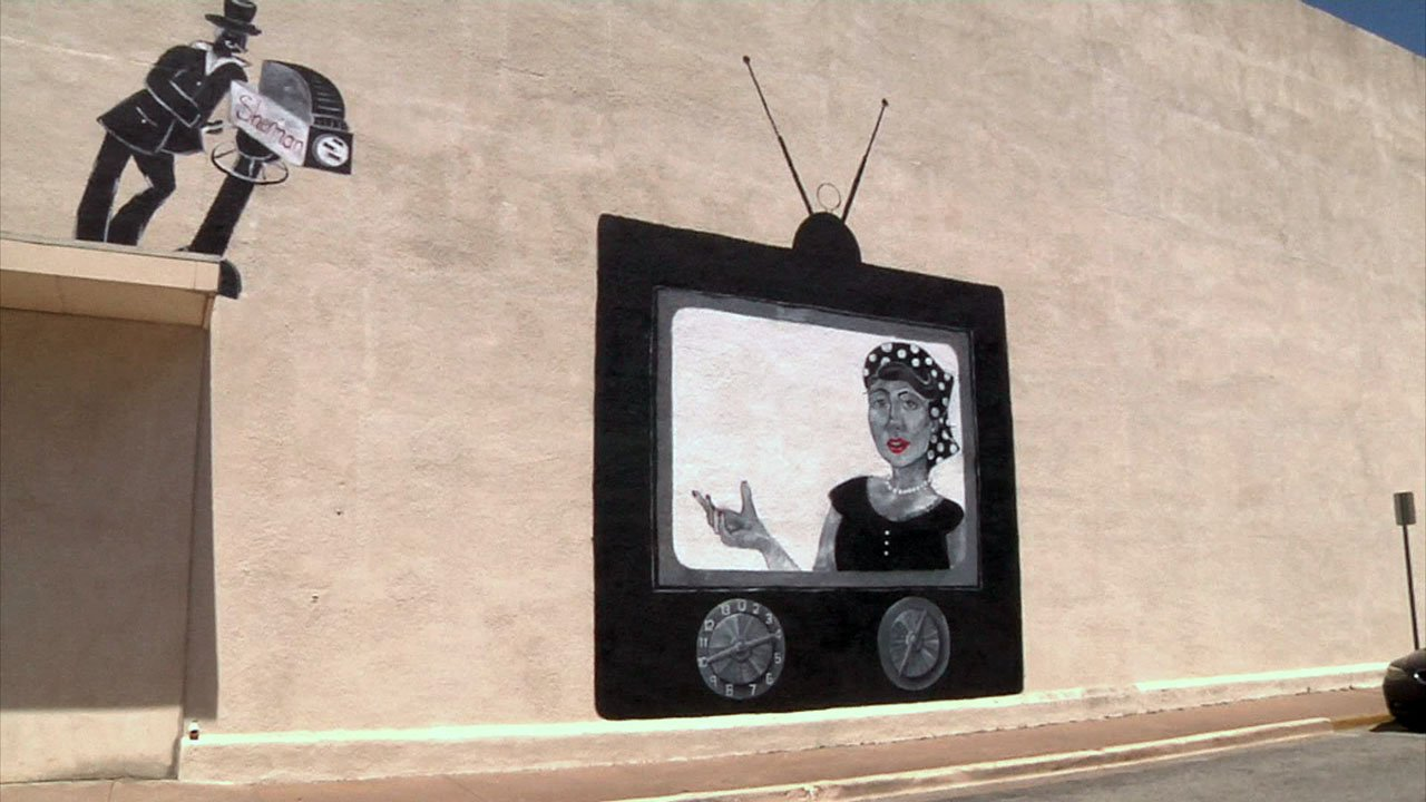 This new mural in downtown Sherman is expected to be finished by the end of April. (KTEN)