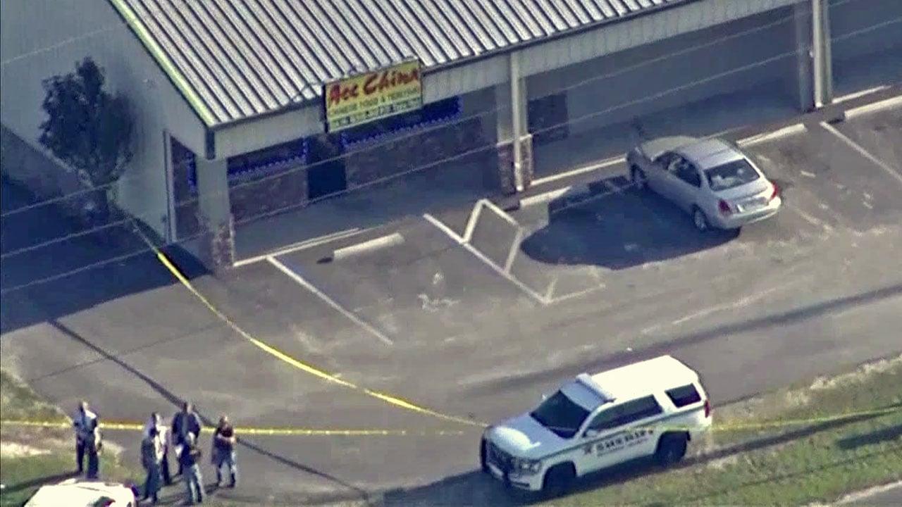 Police surround the restaurant in Trenton, Florida, where two deputies were shot and killed. (WFLA via NBC News)