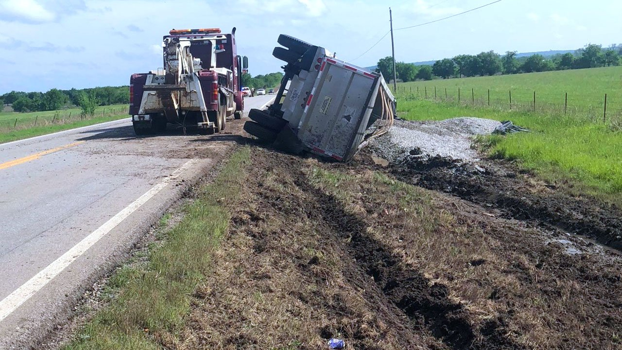 A gravel hauler overturned on State Highway 48 south of Kenefic on May 3, 2018. (KTEN)