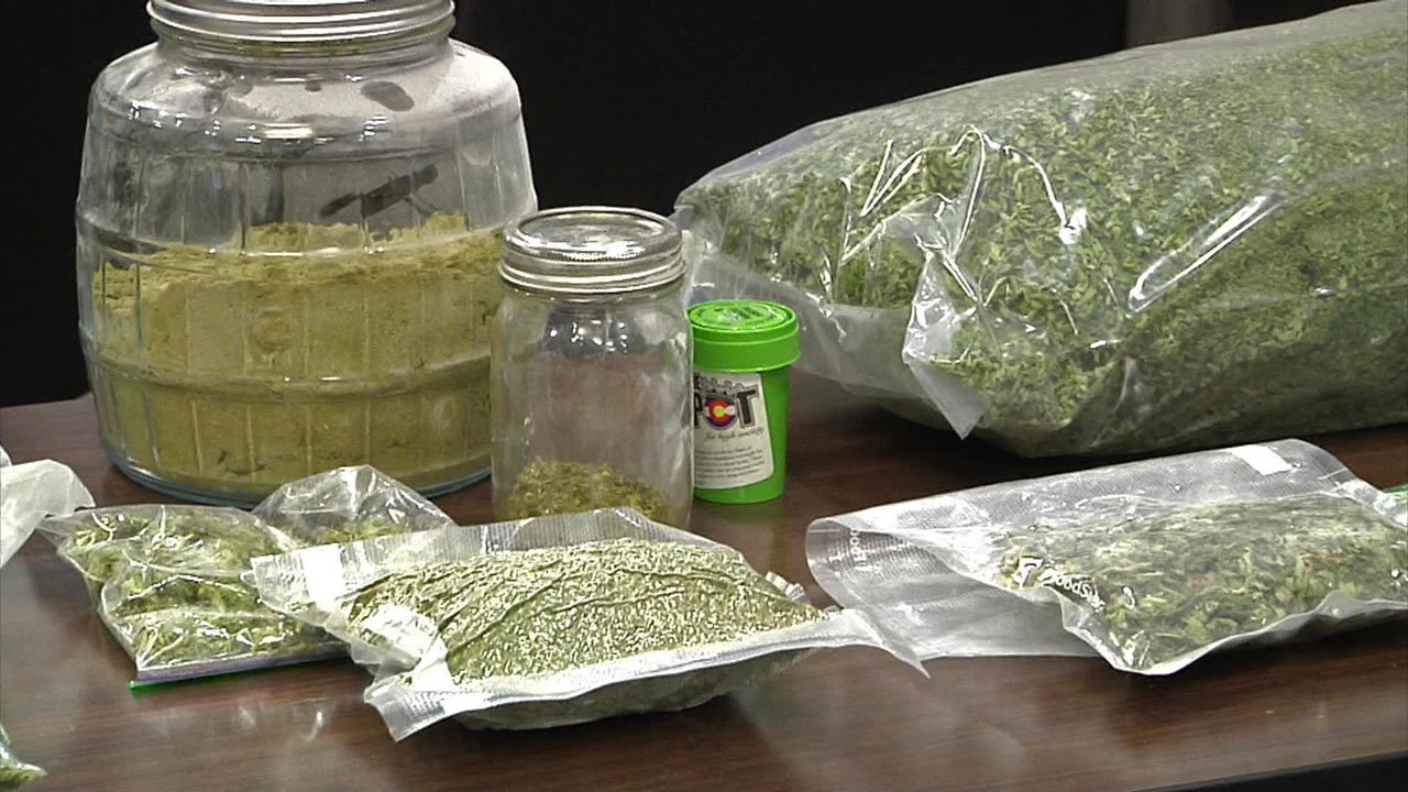Denison police displayed drugs and cash seized in a Pottsboro raid on May 3, 2018. (KTEN)