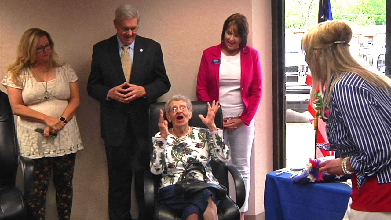Cora Smith reacts with joy at her surprise 94th birthday party in Tishomingo. (KTEN)