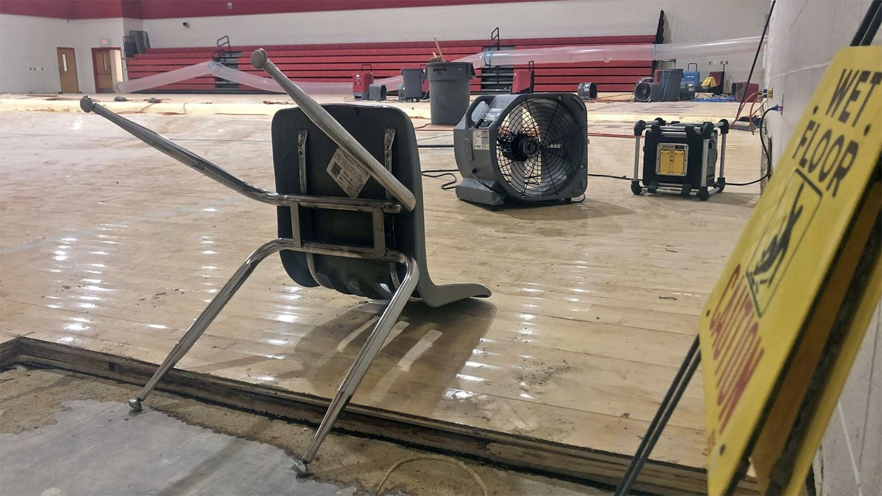 The gymnasium floor at Ardmore Middle School was damaged by a burst water pipe. (KTEN)