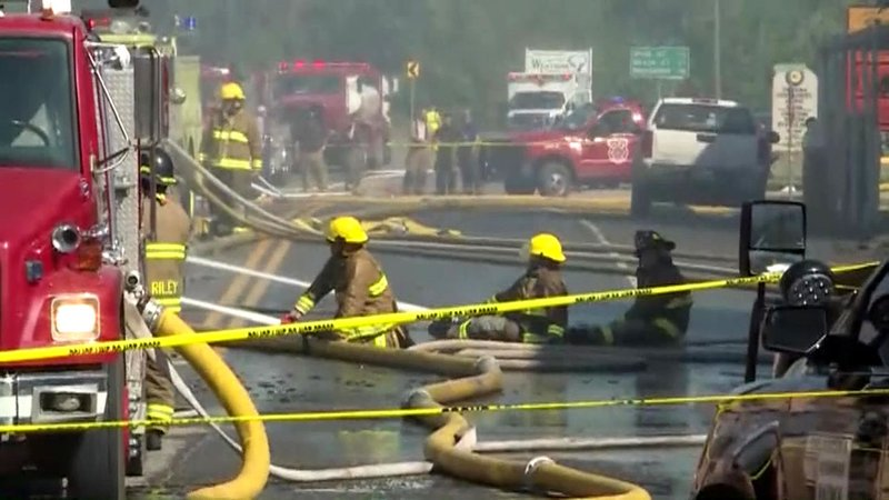 Firefighters work to contain the blaze consuming historic buildings in downtown Talihina, Oklahoma. (KHBS/KHOG via CNN)