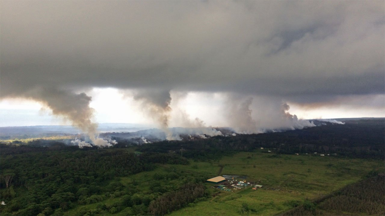 Sulfur dioxide plumes rise from fissures along a rift in the Kilauea volcano on May 16, 2018. (USGS photo)