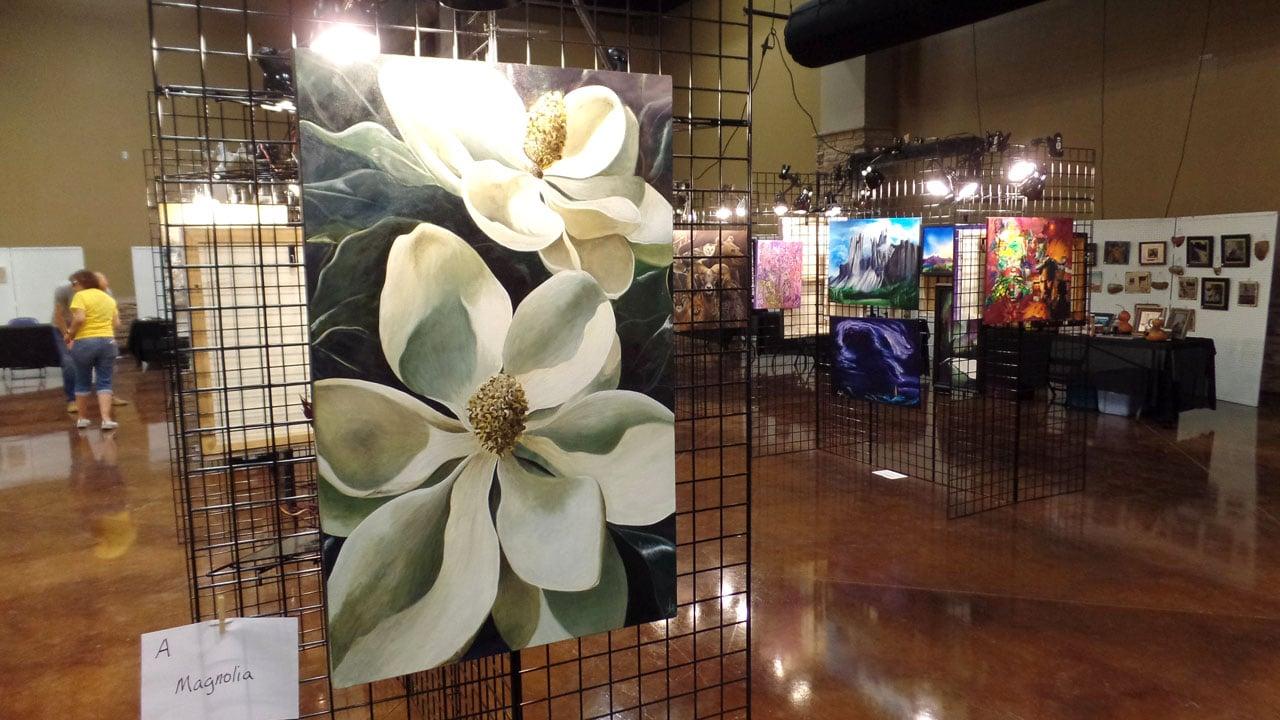 Scene from the art exhibit at the 2017 Magnolia Festival in Durant. (KTEN)