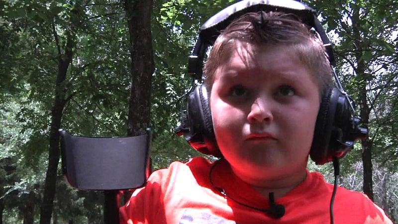 Tripp, 7, used a new metal detector to track down treasure in his Lone Grove backyard. (KTEN)