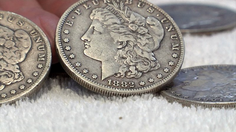 Coins from the 1880s are a part of what Tripp unearthed. (KTEN)