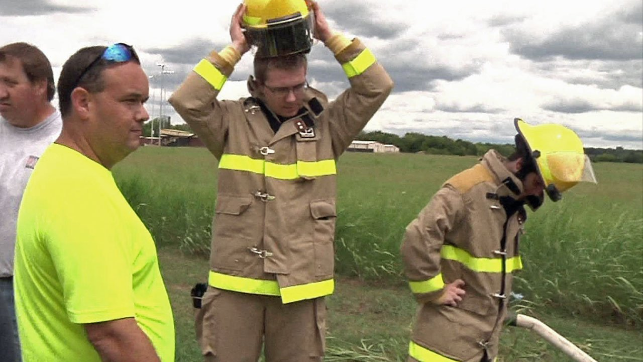 A 2016 photo of Wapanucka Volunteer Fire Department Chief Gary Reeder (left) supervising the training of recruits. (File/KTEN)