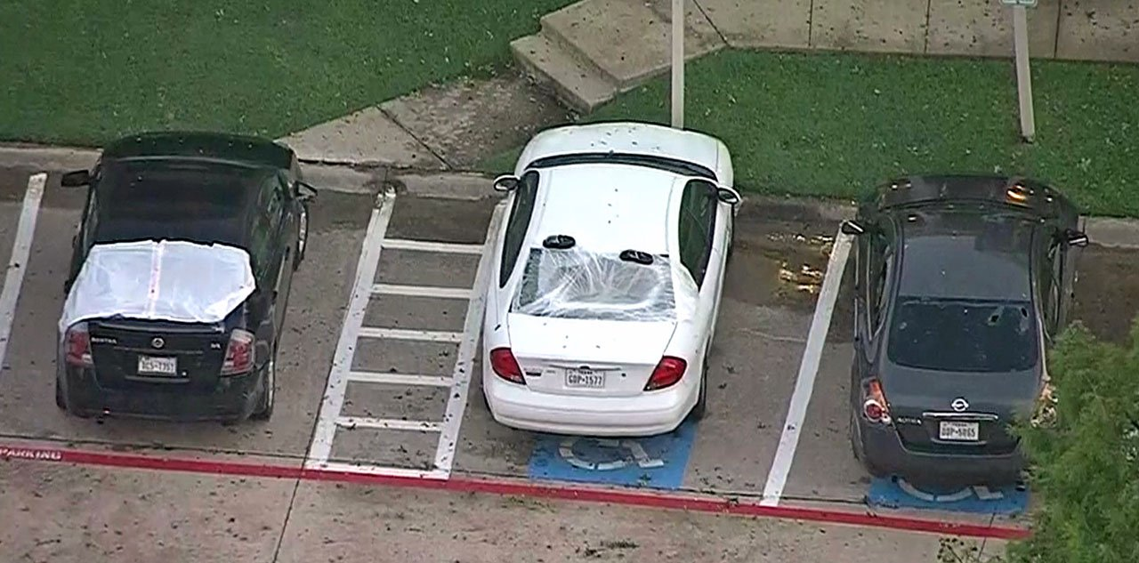Cars damaged in the Dallas-area hailstorm on June 6, 2018. (KTVT via CNN)