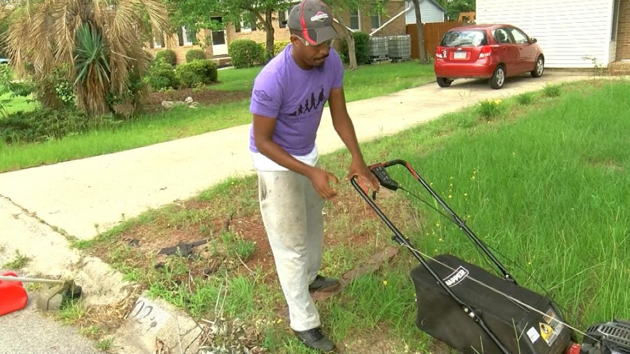 Rodney Smith mowing a lawn in Lexington, South Carolina. (WIS)