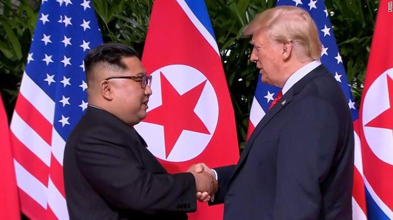 North Korean leader Kim Jong Un shakes hands with President Donald Trump in Singapore. (CNN)