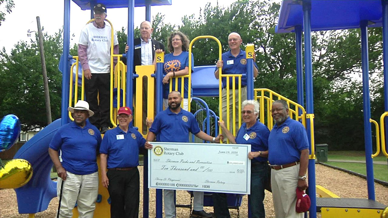 The Sherman Rotary Club presents a $10,000 check to city officials at the dedication of the new Hawn Park playground on June 19, 2018. (KTEN)