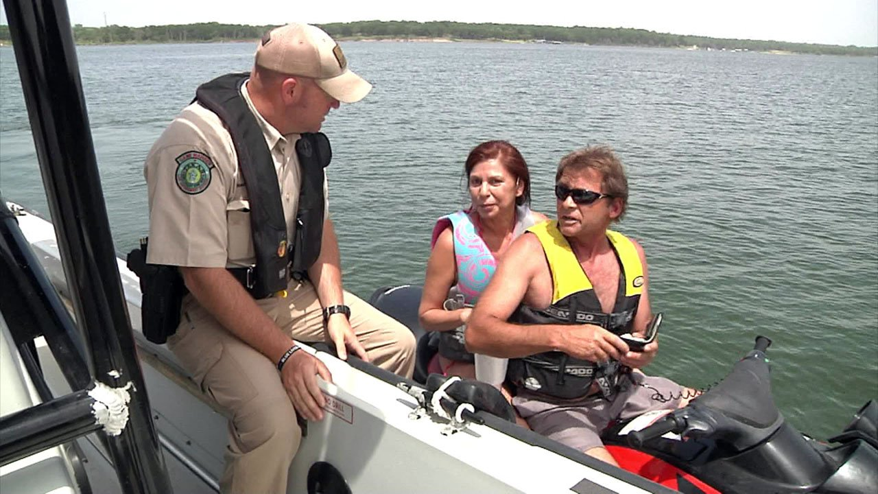 Texas Game Warden Daron Blackerby talks with the operator of a personal watercraft on Lake Texoma. (KTEN)