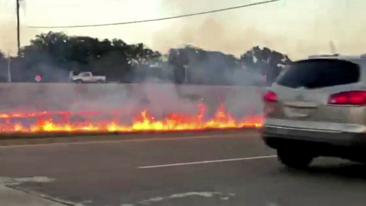 A series of grass fires along U.S. 75 in Denison was sparked by a pickup truck being pursued by police on July 3, 2018. (KTEN)