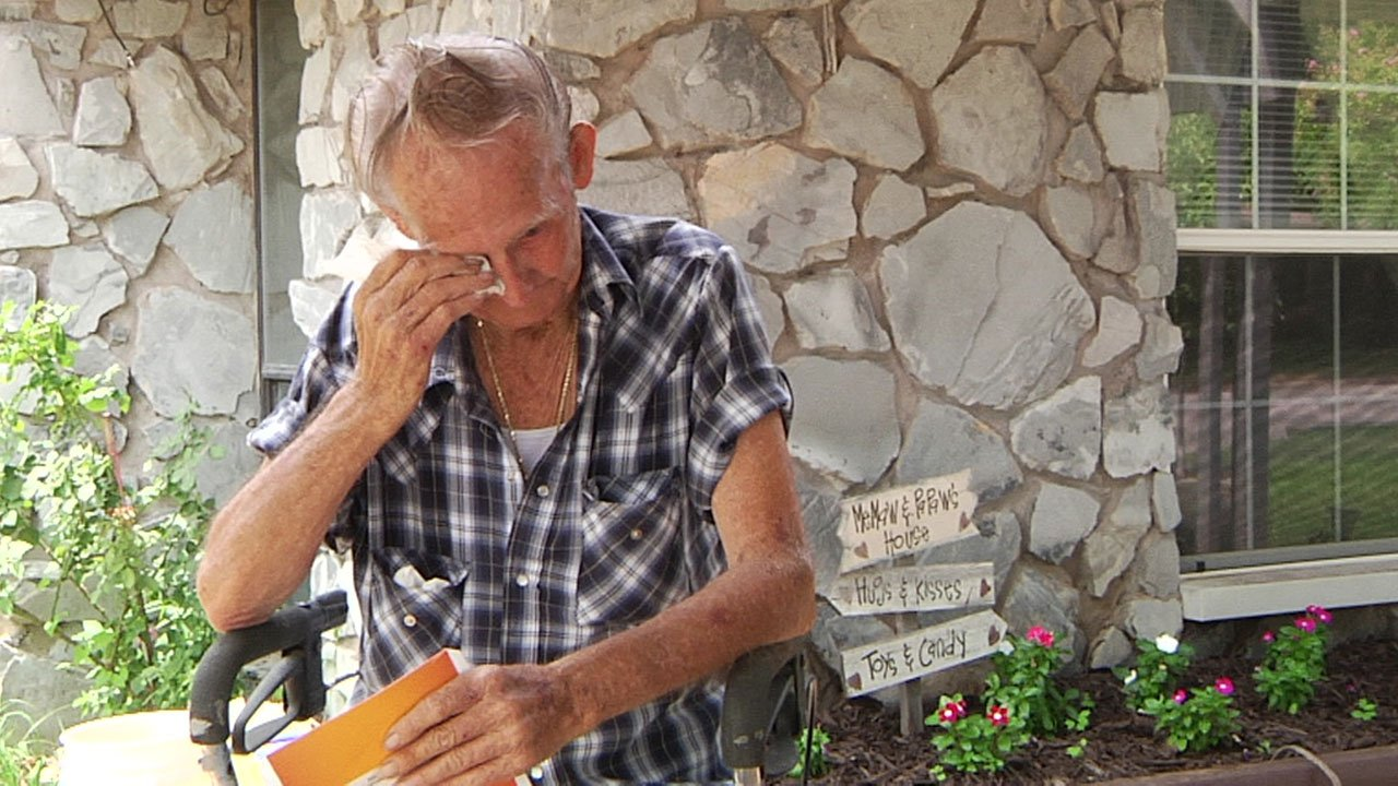 James Holt wipes away a tear as he talks about the theft of a trailer that his late son built for him. (KTEN)