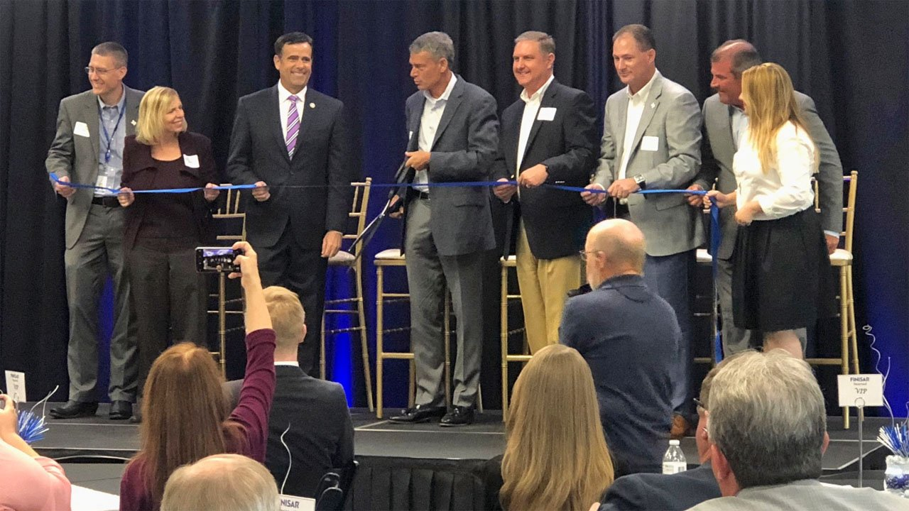 Finisar CEO Michael Hurlston cuts the ribbon at the company's new Sherman manufacturing plant on July 9, 2018. (KTEN)
