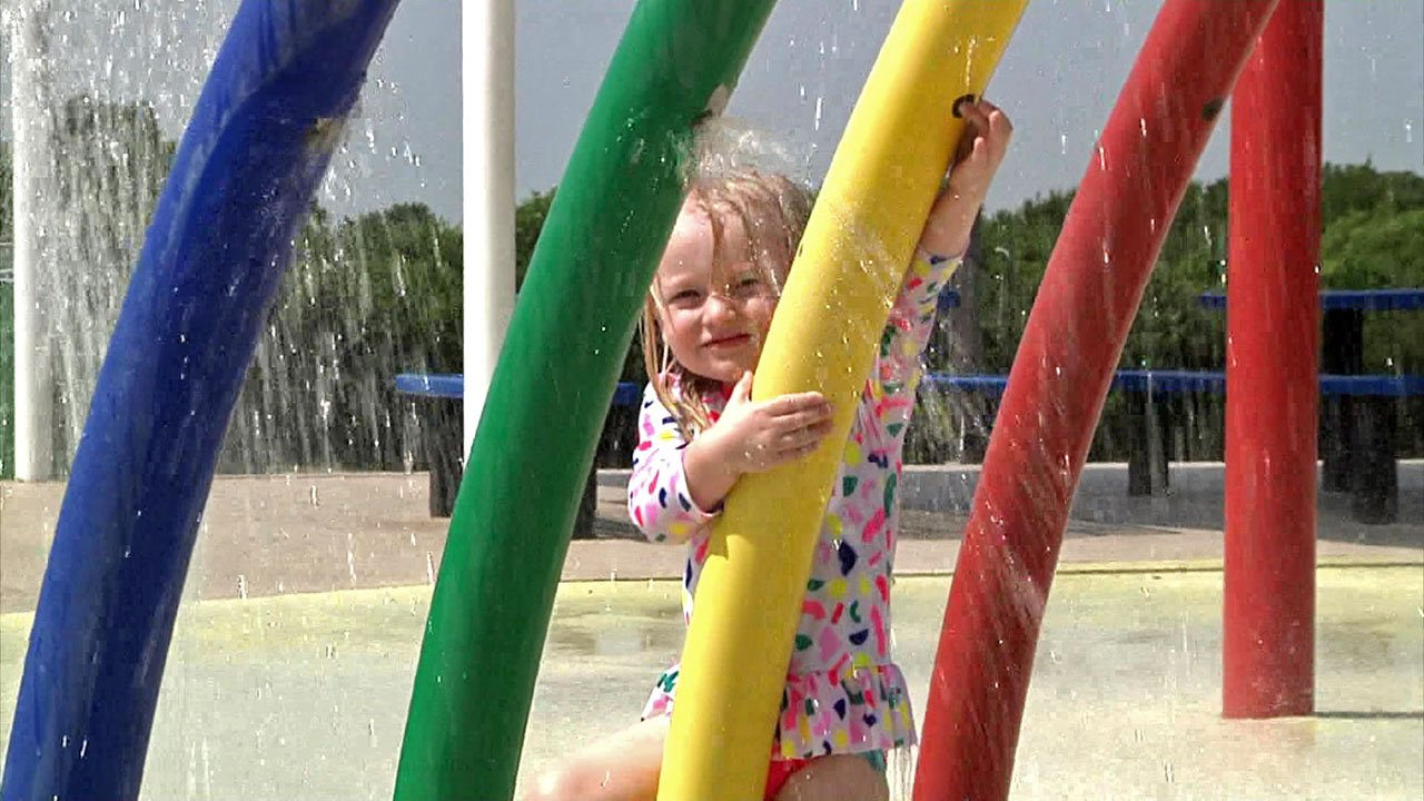 This little girl stays cool at a Grayson County splash park. (KTEN)